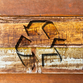 recycle sign on wood background