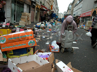 People picking up unsold fruits on the street stock photo