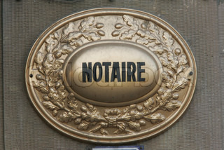 Close-up of notary bronze sign
