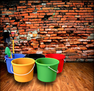 Bucket and shovel with a brick wall