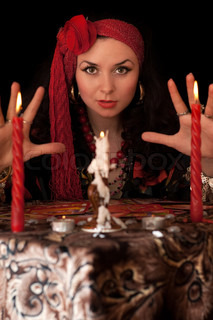 Witch at the table with candles Isolated