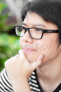 asian thai chinese smiled smart man with glasses thinking consulting