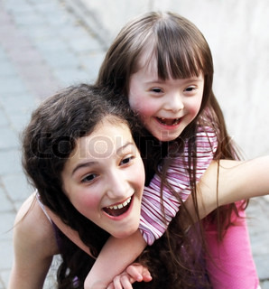 Portrait of beautiful young girls outside