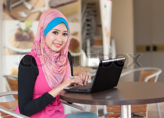 Portrait of the pretty muslim women with the laptop