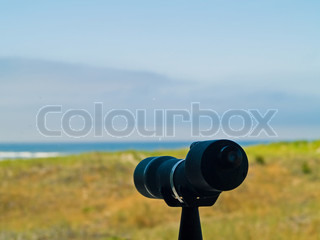Spotting Scope Pointing to the Beach and Ocean in the Distance