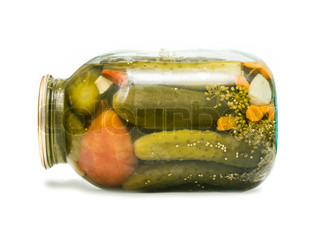 canned tomatoes and cucumbers in a glass jar isolated on white background