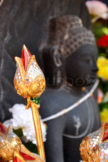 Artificial lotus and Statue of Buddha
