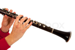 Hands playing on clarinet Isolated over white background