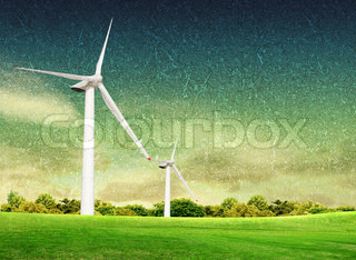 Grunge wind turbine on the green grass over the blue clouded sky