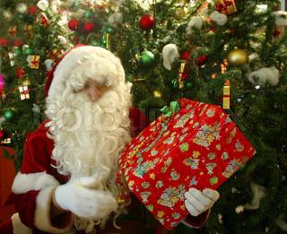 Santa Claus holding a Christmas present