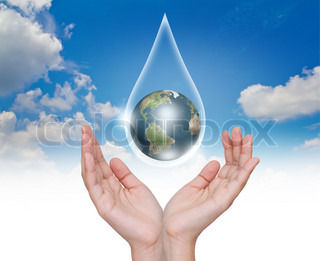Eco concept : Hand with earth in water drop