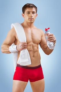 a handsome young sportsman with water