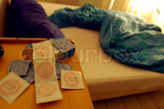 Image of 'condom, bed, condoms'