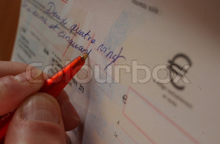 Cropped view of person writing a check