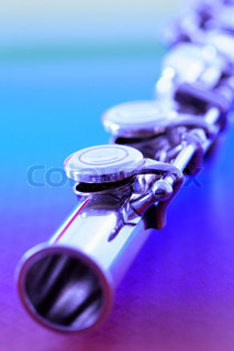 detail of transverse flute on blue and purple background