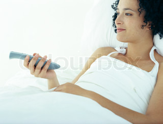 Image of 'bed, woman, man'