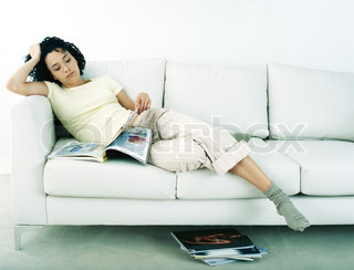 Image of 'couch, woman, cocooner'