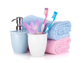 Toothbrush, soap, two towels and flower