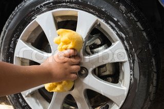 Outdoor tire car wash with yellow sponge