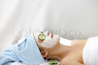 A caucasian woman in a wellness spa getting facial treatment