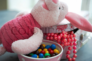 Stuffed toy and bowl of chocolates