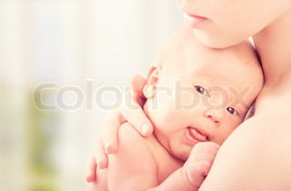 newborn baby in the arms of mother