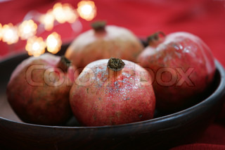 Bowl of pomegranate used for Christmas decoration
