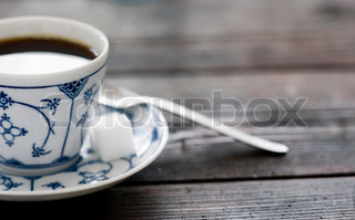 Cup of black coffee with sugar