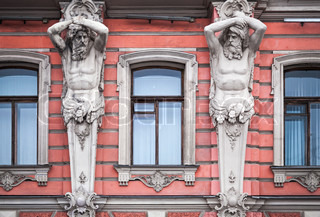 Facade with men statues of an old palace in StPetersburg, Russia Belosselsky-Belozersky Palace is Neo-Baroque style was built in 1847-48 by project of Andrei Ivanovich Stakenschneider
