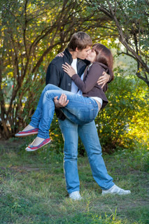 romantic young couple kissing...
