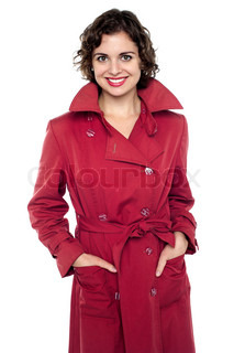Young fashion female wearing trendy topcoat