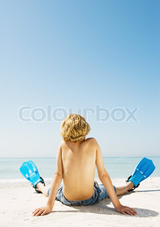 Image of 'beach, kid, relax'
