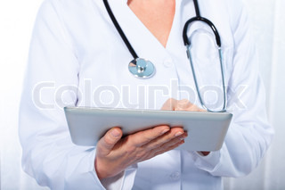 doctor working withtablet,