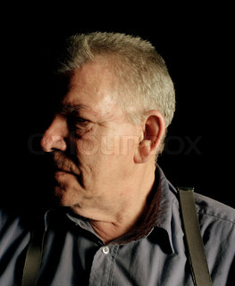 Side view of an elderly man's face