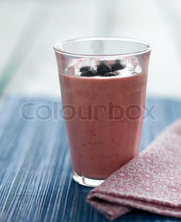 Smoothie in a glass with blueberries