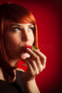 Sexy girl eating stawberry