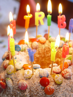 Close-up on colourful candles on birthday cake