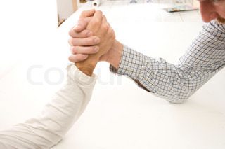 Two men in arm wrestling