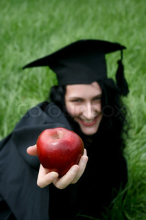 Young smiling caucasian student with apple