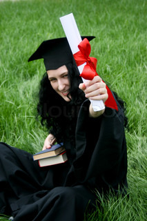 Smiling caucasian student with diploma