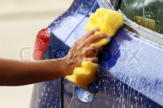 outdoor car wash with yellow spong