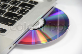 cd or dvd disk in the drive of a laptop