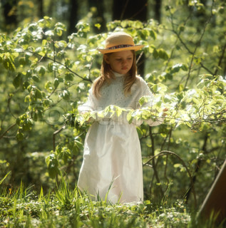 A young scandinavian girl in the summer forest