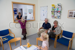 Children in a family clinic with their grandparents