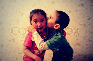 Image of 'kiss, children, sincerity'