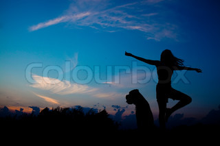 girl with a dog jumping silhouette
