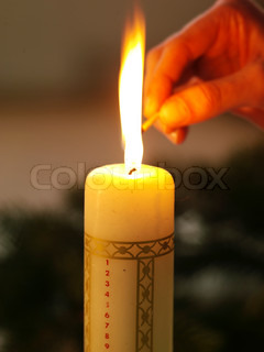 Lighting the advent  candle used for Christmas decoration