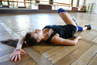 Young caucasian woman dancer on the floor