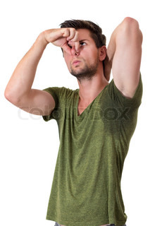 Man sweating very badly under armpit and pointing there for How to get armpit stains out of colored shirts