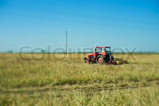 Tractor on a green field